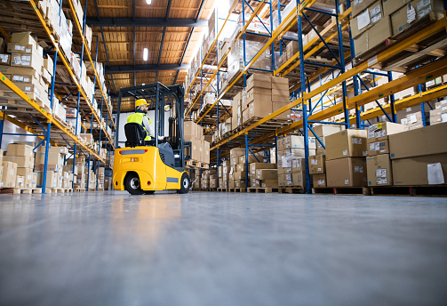 Warehouse man worker with forklift. 897280394
