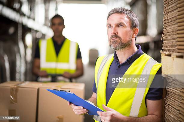 warehouse manager checking deliveries