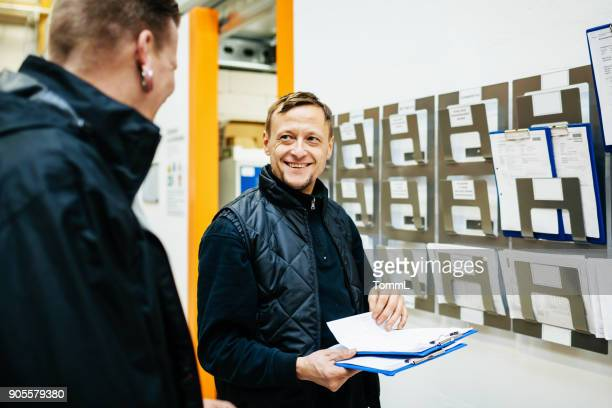 warehouse manager organising schedule for the week - time stock photos and pictures