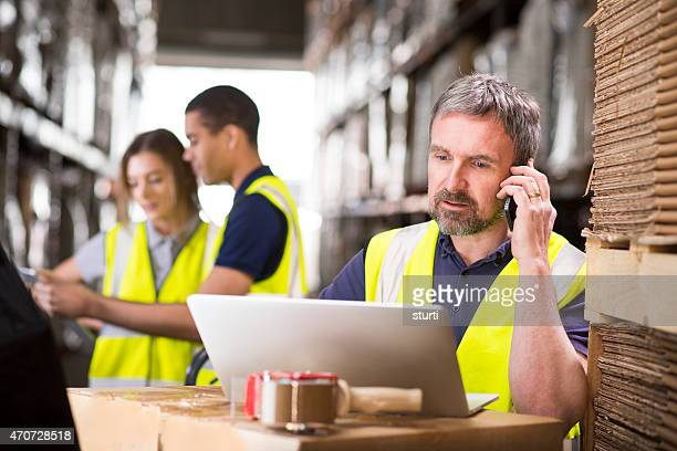 warehouse manager ringing a customer