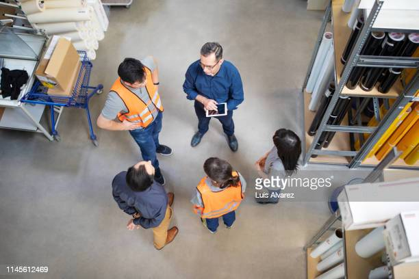 warehouse manager talking to employees - hearing protection stock pictures, royalty-free photos & images