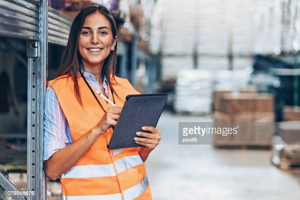 warehouse manager with digital tablet - safety stock pictures, royalty-free photos & images