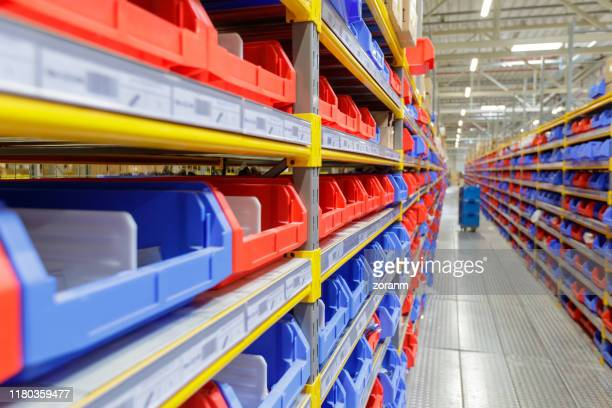 warehouse racks in empty warehouse - industrial storage bins stock pictures, royalty-free photos & images