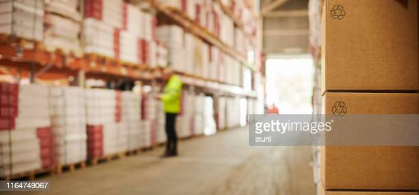 warehouse recycled packaging - making stock pictures, royalty-free photos & images