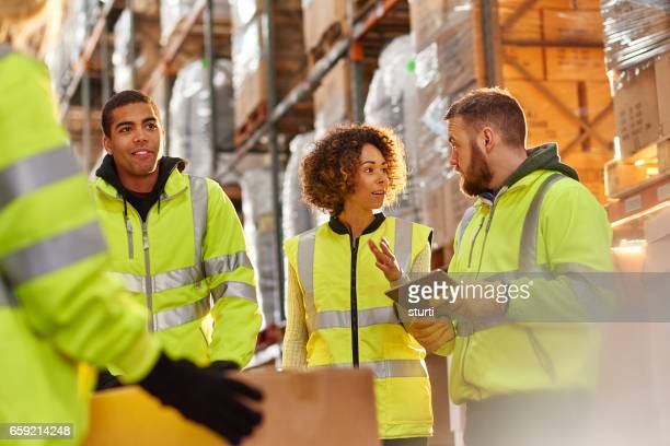 warehouse staff chat - reflective clothing stock pictures, royalty-free photos & images