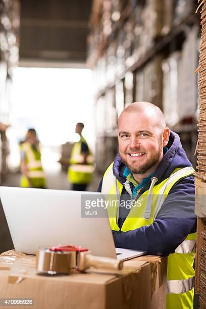 warehouse supervisor smiling to camera