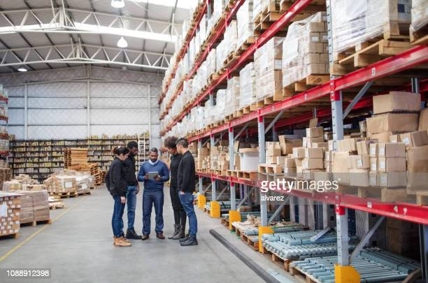 warehouse team meeting - making stock pictures, royalty-free photos & images