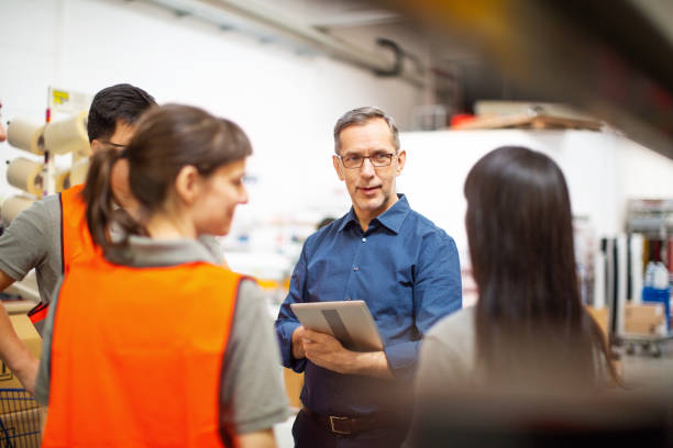 warehouse team meeting - technical advisory stock pictures, royalty-free photos & images