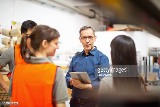 warehouse team meeting - manager stock pictures, royalty-free photos & images