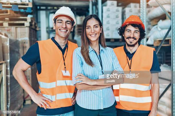 warehouse team - waistcoat stock pictures, royalty-free photos & images