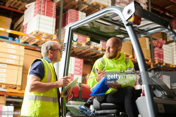 warehouse teamwork - making stock pictures, royalty-free photos & images