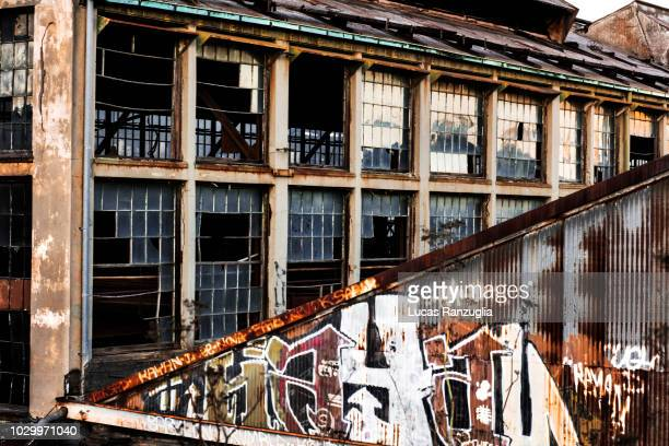 warehouse view with grafitti in dogpatch,  san francisco, california - dogpatch stock pictures, royalty-free photos & images