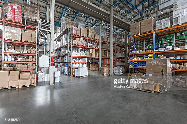 Warehouse with cardboard boxes on pallet truck