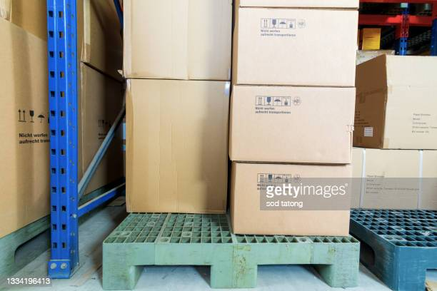 warehouse with inaccurately stored cardboard boxes - luggage hold stock pictures, royalty-free photos & images