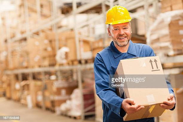 Warehouse worker carrying box