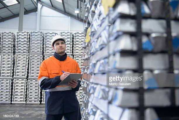 Warehouse worker checking stock