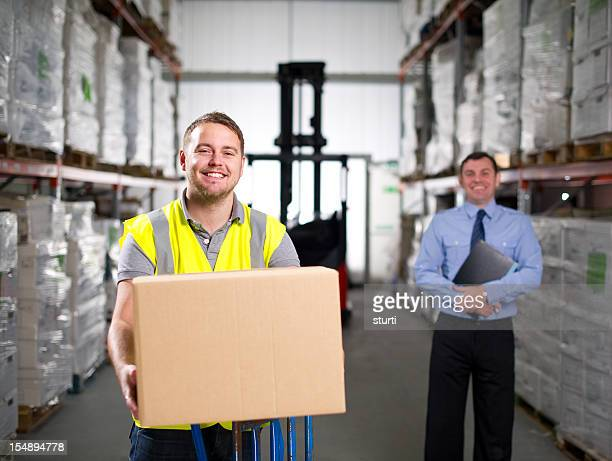 Warehouse Worker Holding a Box