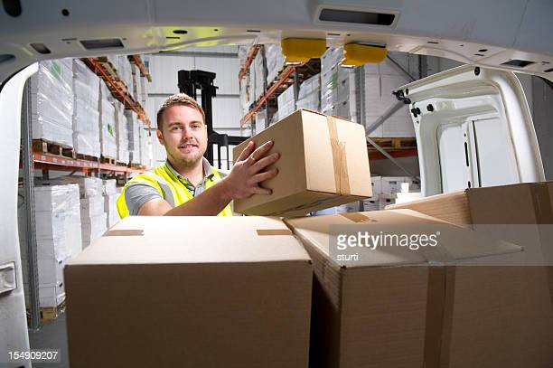 warehouse worker loading a delivery van - van stock pictures, royalty-free photos & images