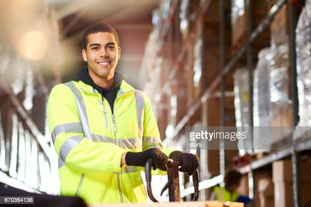 warehouse worker portrait - reflective clothing stock pictures, royalty-free photos & images