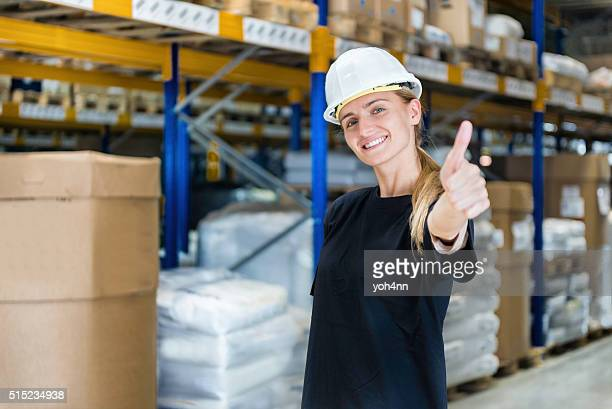 Warehouse worker showing thumb up