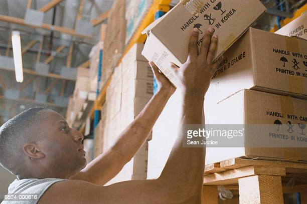 warehouse worker stacks box - post structure stock pictures, royalty-free photos & images