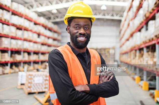 Warehouse worker standing confidently