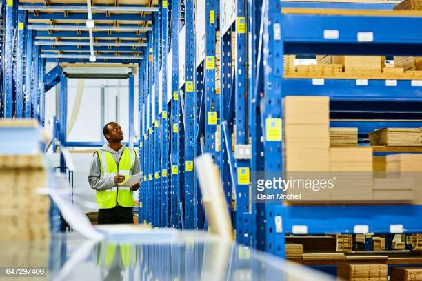 Warehouse worker taking inventory of products