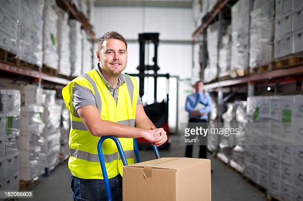 warehouse worker using a hand truck - sack barrow stock pictures, royalty-free photos & images