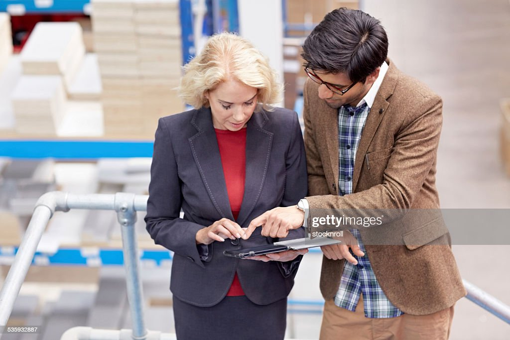 Warehouse worker using digital tablet : Stock Photo