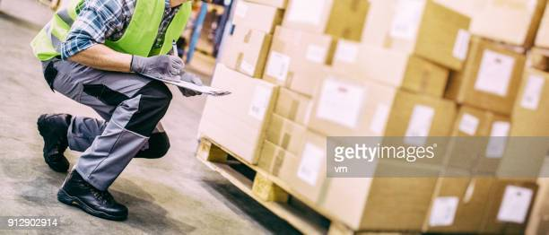 warehouse worker with clipboard checking packages - work glove stock pictures, royalty-free photos & images