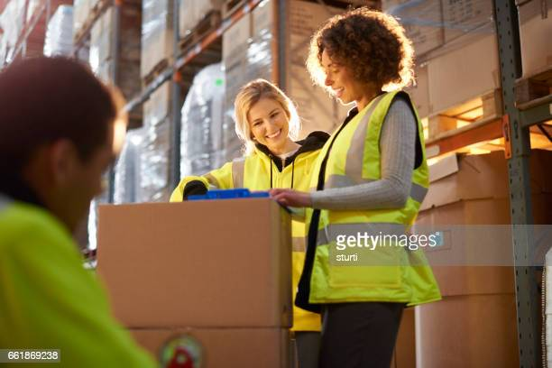 warehouse worker with her trainer