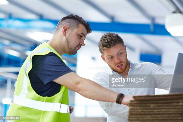 Warehouse worker working together