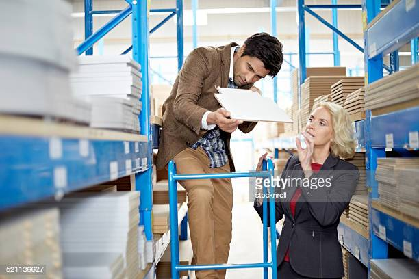 Warehouse workers checking the quality of goods