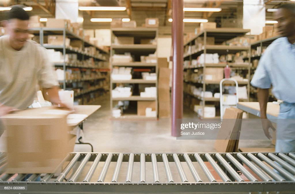 Warehouse Workers Pack Boxes : Stock Photo