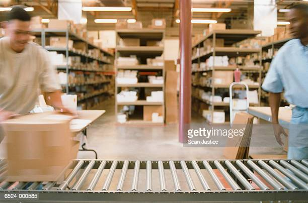 Warehouse Workers Pack Boxes
