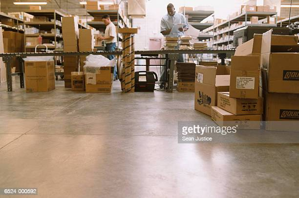 warehouse workers pack boxes - post structure stock pictures, royalty-free photos & images