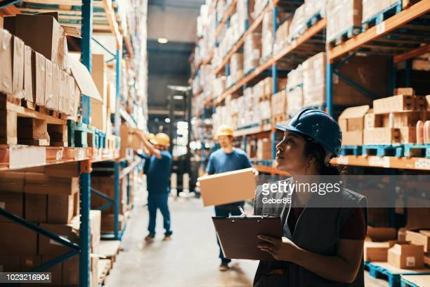 warehouse workers - making stock pictures, royalty-free photos & images