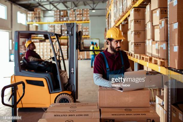 warehouse workers - transportation stock pictures, royalty-free photos & images