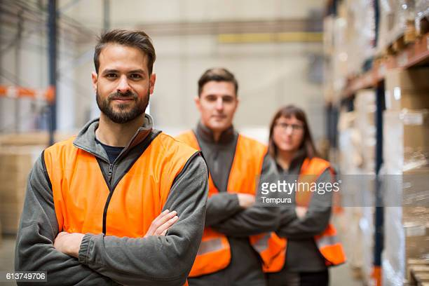 Warehouse workers portrait in work overalls