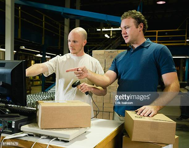 Warehouse workers scanning packages
