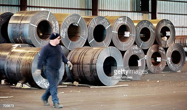 A warehouseman walks past coils of steel from Holland waiting for shipment to Ford Motor Company in Ohio from a warehouse at the South Jersey Port...