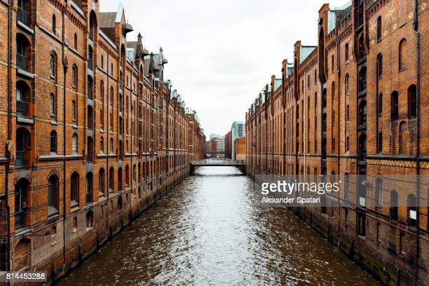 Warehouses along the canal in Speicherstadt, Hamburg, germany