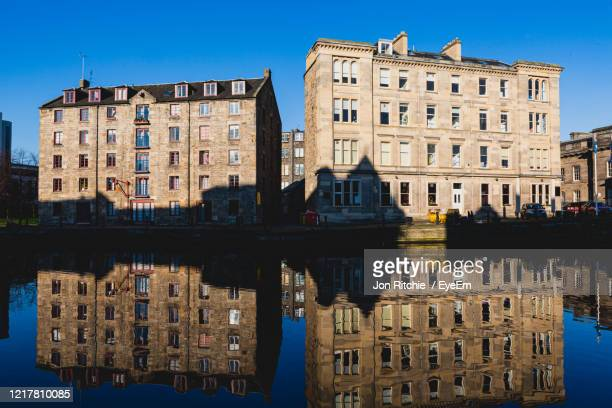 warehouses and reflections in leith, edinburgh, scotland - edinburgh stock pictures, royalty-free photos & images