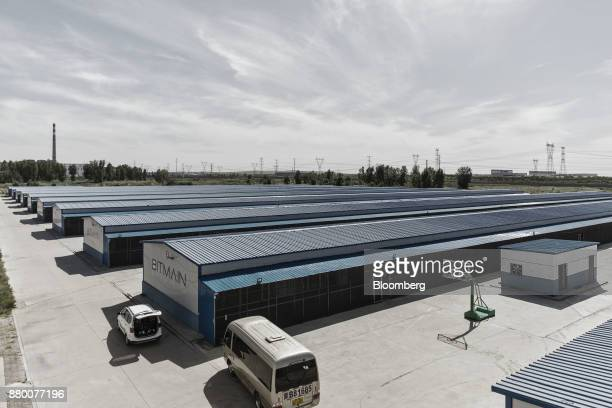 Warehouses storing bitcoin mining machines stand at a mining facility operated by Bitmain Technologies Ltd in Ordos Inner Mongolia China on Friday...