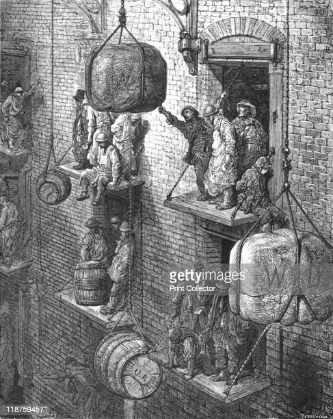 Warehousing in the City' 1872 Men and boys lifting bales and barrels at warehouse depot From LONDON A Pilgrimage by Gustave Dore and Blanchard...