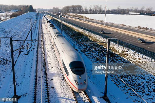 Waremme Wallonia Belgium January 19 2016 A highspeed train German ICE is passing beside a highway offered by DB Fernverkehr and is the flagship of...