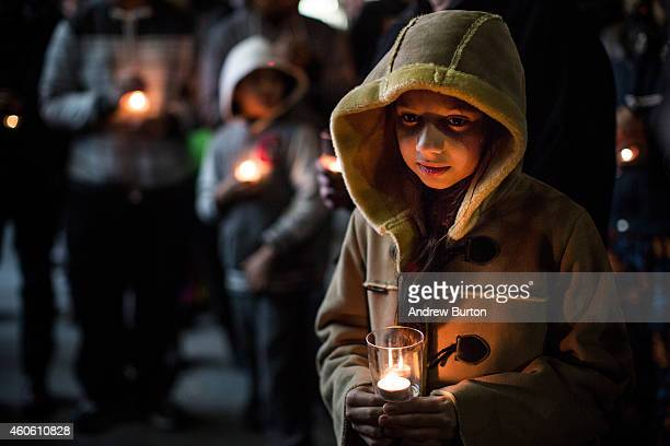Warisha Umair age 5 attends a candlelight vigil for the 132 students killed in a terror attack yesterday in Pakistan on December 17 2014 in the...