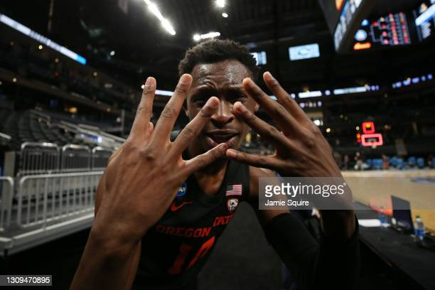 Warith Alatishe of the Oregon State Beavers celebrates after defeating the Loyola-Chicago Ramblers in the Sweet Sixteen round of the 2021 NCAA Men's...
