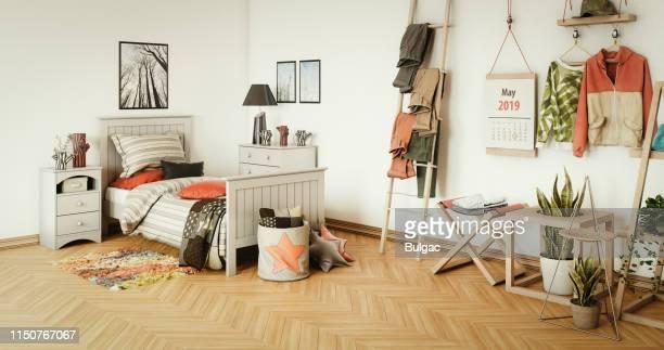 warmes und gemütliches schlafzimmer - jugendkultur stock-fotos und bilder