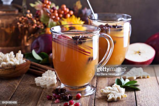 warm apple cider with spices - tea hot drink stock pictures, royalty-free photos & images